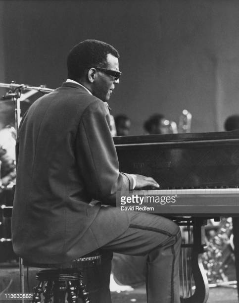 Ray Charles US singer and pianist playing the piano during a live concert performance in Comblain la Tour Belgium circa 1964