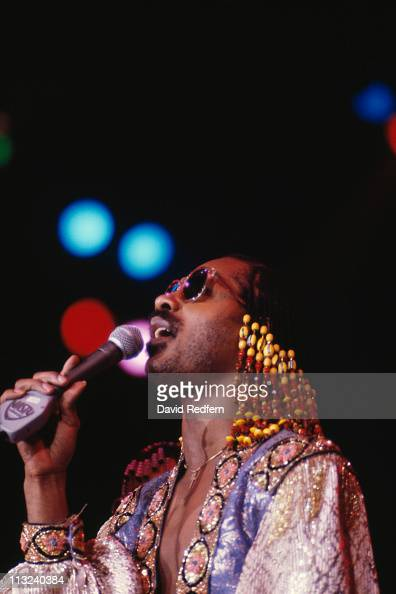 Stevie Wonder US singersongwriter singing into a microphone during a live concert performance at Wembley Arena London England Great Britain in...