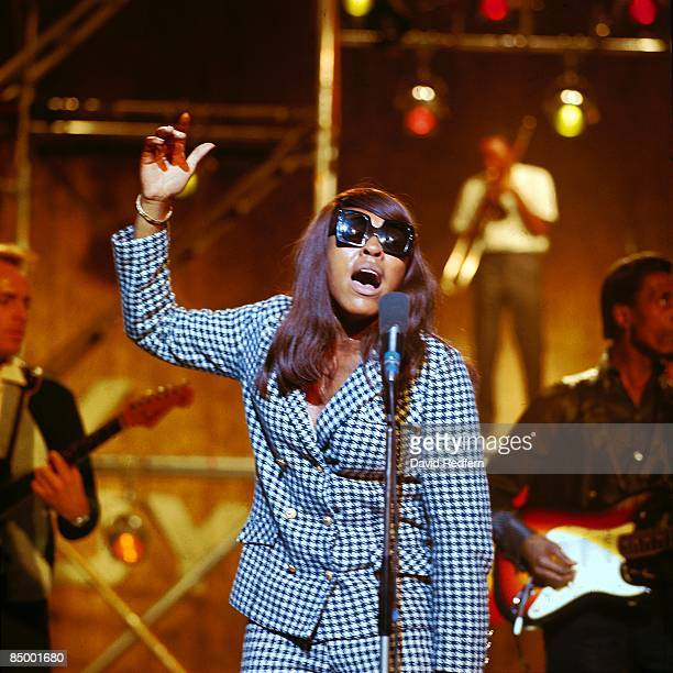 GO Photo of Ike Tina TURNER and Ike TURNER and Tina TURNER with Ike Tina Turner performing at Wembley Studios wearing sunglasses