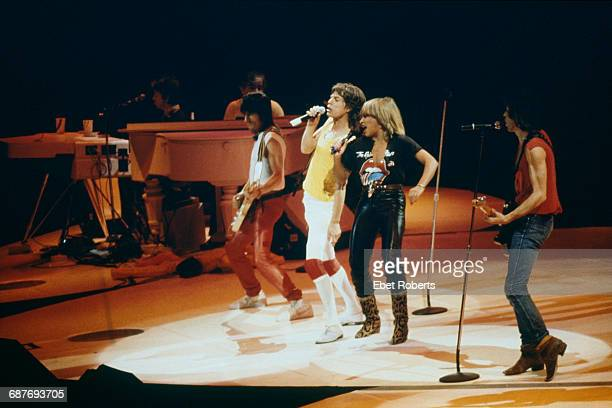 American singer Tina Turner performing with the Rolling Stones at the Brendan Byrne Arena part of the Meadowlands Sports Complex in East Rutherford...