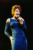 American singer Whitney Houston performing at the NYNEX arena in Manchester 9th July 1998