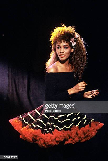 American singer Whitney Houston wearing a striped circle skirt 1987