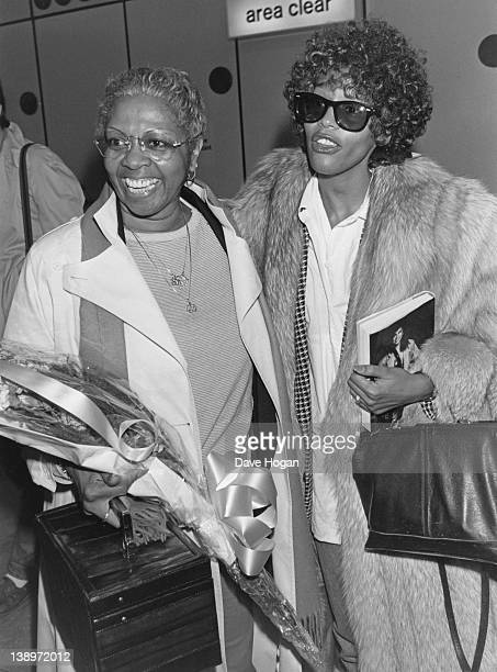 American singer Whitney Houston with her mother Cissy Houston at Heathrow Airport in London upon her return from the San Remo Rock Festival in Italy...