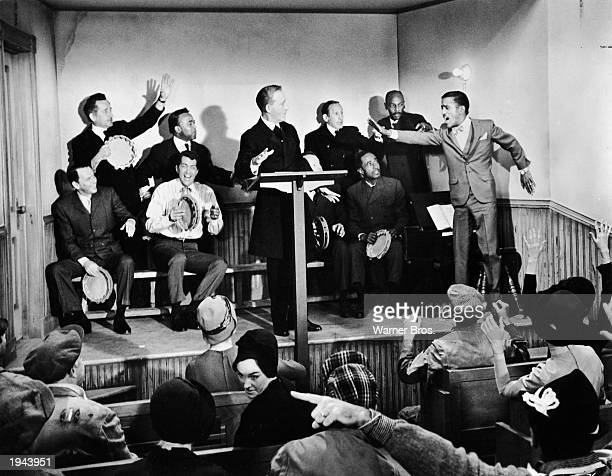 American singers and actors Sammy Davis Jr Frank Sintra Dean Martin and others in a church in a still from the film 'Robin and the Seven Hoods'...