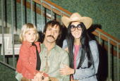 American singers and actors Sonny and Cher Bono pose with their daughter Chastity in front of a staircase March 1 1973