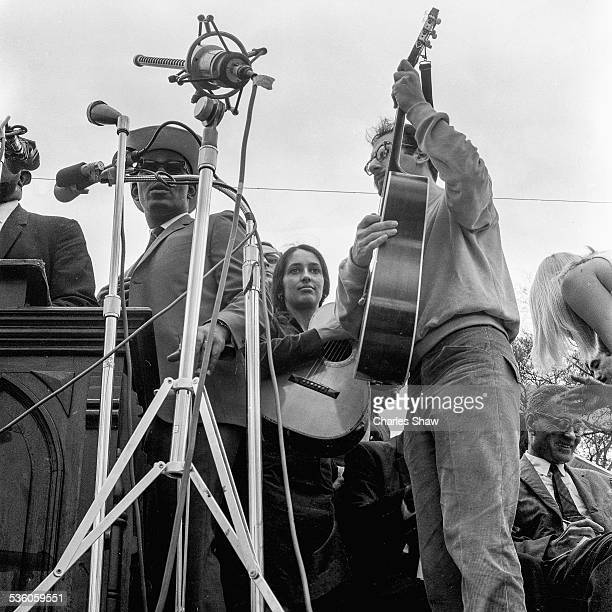 American singers and Civil Rights activists Joan Baez and Peter Yarrow perform on the podium in front of the Alabama State Capitol at the end of the...