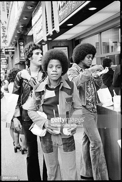 American singers Marlon and Jermaine Jackson of the Jackson Five eat out at a McDonalds in Japan 7th May 1973