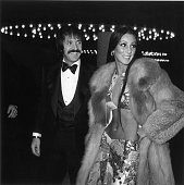 American singers Sonny and Cher attend the Golden Globe Awards Los Angeles California Sonny Bono wears a tuxedo Cher wears a midriffbaring two piece...