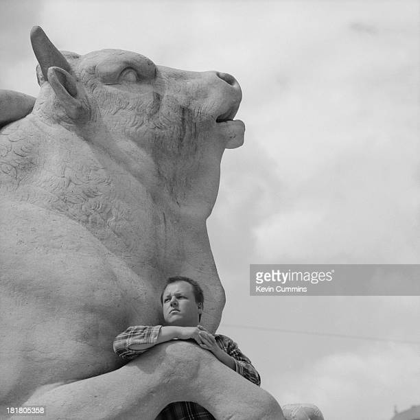 American singersongwriter and guitarist Black Francis of American rock group The Pixies Munich Germany 1990 Black is posing on a statue of the...