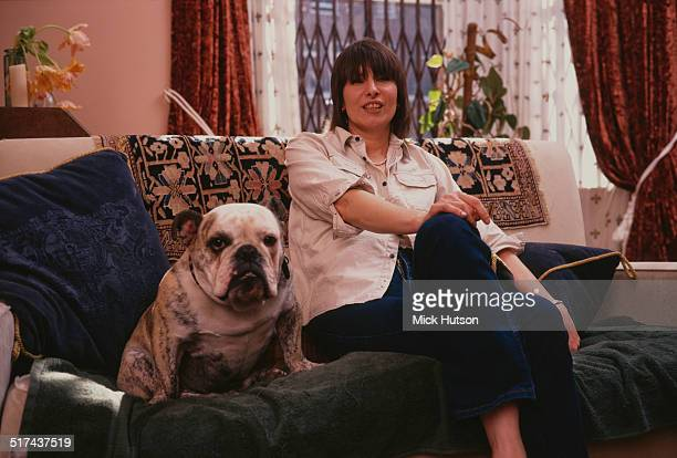 American singersongwriter and guitarist Chrissie Hynde of rock group The Pretenders at home with her dog UK 1999
