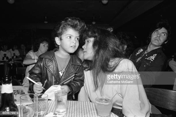 American singersongwriter and music producer Bruno Mars left shown here as a four year old Elvis impersonator with his mother in August 1990 in...