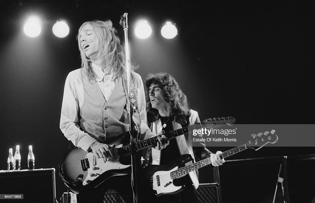 American singer-songwriter and musician Tom Petty performs live with the Heartbreakers, circa 1977. Behind him is bassist Ron Blair.