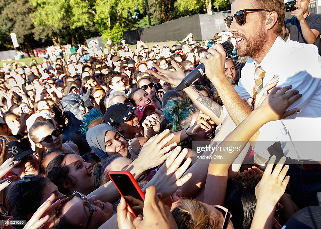 American singersongwriter Andrew McMahon greets the audience during his performance at Deer Lake Park Festival Lawn on July 28 2016 in Burnaby Canada