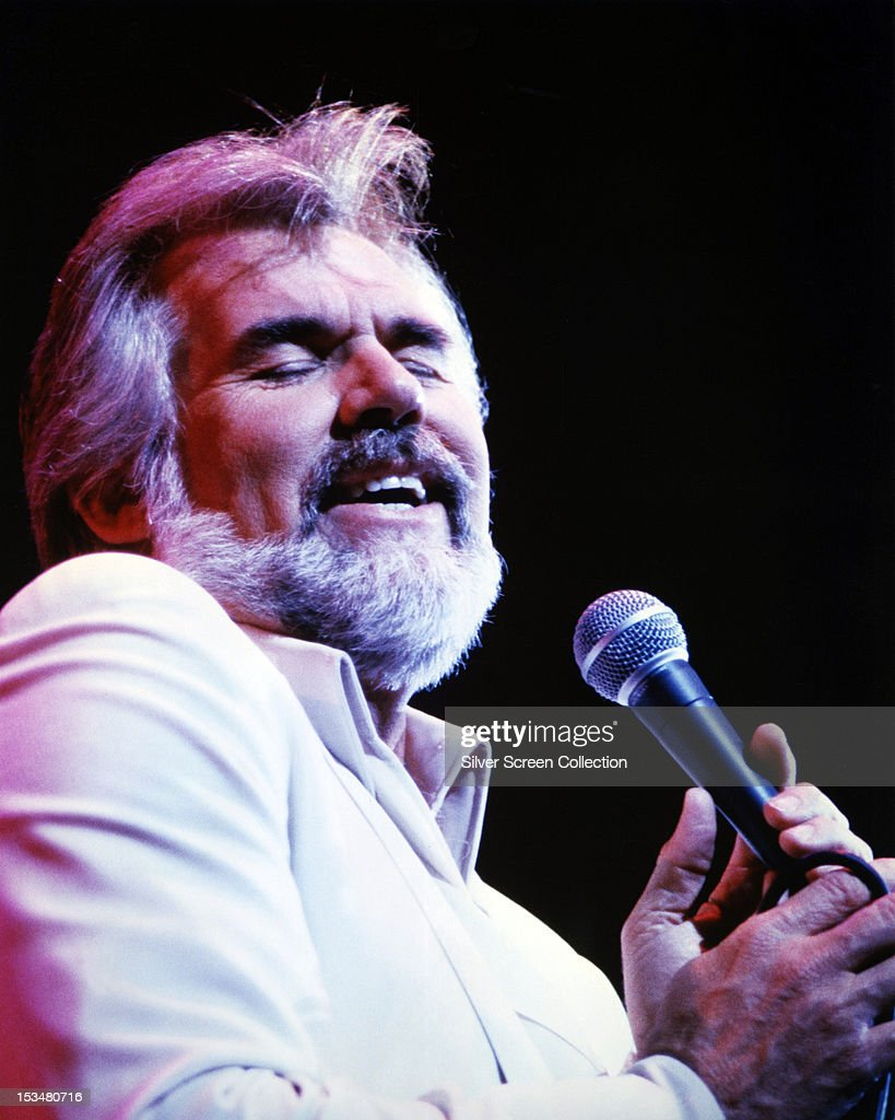 American singer-songwriter <a gi-track='captionPersonalityLinkClicked' href=/galleries/search?phrase=Kenny+Rogers+-+Singer&family=editorial&specificpeople=4246341 ng-click='$event.stopPropagation()'>Kenny Rogers</a> performing, circa 1980.