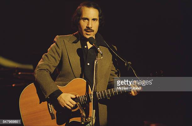 American singersongwriter Paul Simon performing at the Palladium Theatre London December 1975