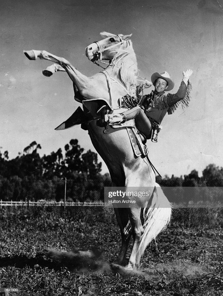 American singing cowboy star Roy Rogers born Leonard Slye riding his horse and longtime costar Trigger