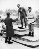 American skater Irving Jaffee shakes hands with an unidentified Olympic official after winning the gold medal in the Men's 5000Metre Speed Skating...