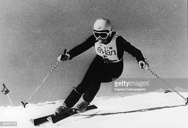 American skier Cindy Nelson lifts her inner foor from the snow as she swings into a high speed turn at the World Cup January 1 1974