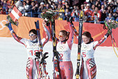 American skier Picabo Street poses on the podium with Austrian skiers Alexandra Meissnitzer and Michaela Dorfmeister Street won the gold medal in the...