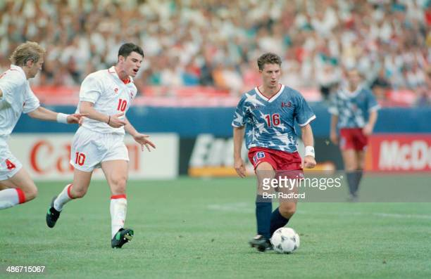 American soccer player John Harkes playing for the USA against Switzerland in a FIFA World Cup Group A match at Pontiac Silverdome Pontiac Michigan...