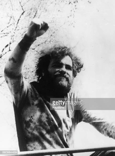 American social activist Jerry Rubin one of the 'Chicago Seven' defendants arrested for counterculture protests raising his fist in the air to...