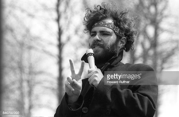 American social and political activist Jerry Rubin gives a 'peace sign' as he speaks during a rally at Kent State University Kent Ohio April 10 1970