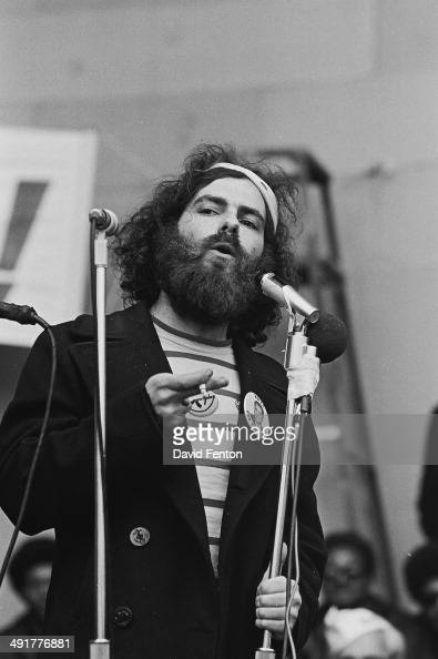 American social and political activist Jerry Rubin speaks at an unspecified protest circa 1970s He wears a button that reads 'Hoffa for President'