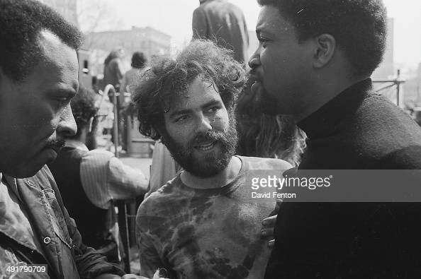 American social and political activist Jerry Rubin speaks to other protestors at a rally in support of Black Panther Party held at New Haven Green on...