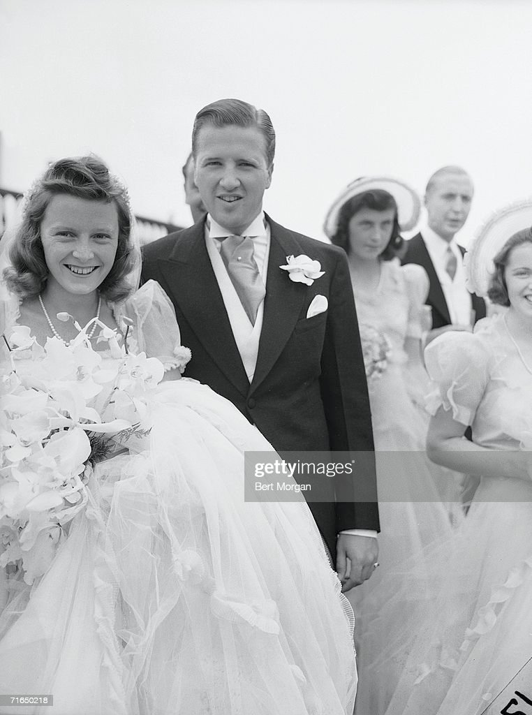 American socialite Anne McDonnell Ford (1920 - 1996) and her new husband automobile executive Henry Ford II (1914 -1987) pose for a portrait at their wedding, Southampton, New York, July 13, 1940. The couple dovorced in 1964.