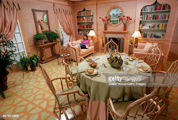American socialite Lee Radziwill lies on a couch and shows off her dining room March 1976