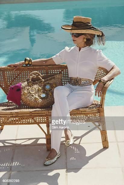 American socialite Lynn Wyatt by a swimming pool in Cap Ferrat France 1991