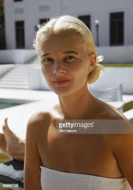 American socialite Mrs Winston F C Guest beside the pool of her oceanfront estate Villa Artemis in Palm Beach Florida circa 1955