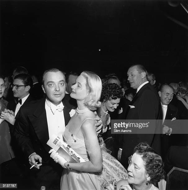 American socialites James Paul Donahue III and CZ Guest at a party given by the Duke and Duchess of Windsor at the Waldorf Astoria on Park Avenue New...