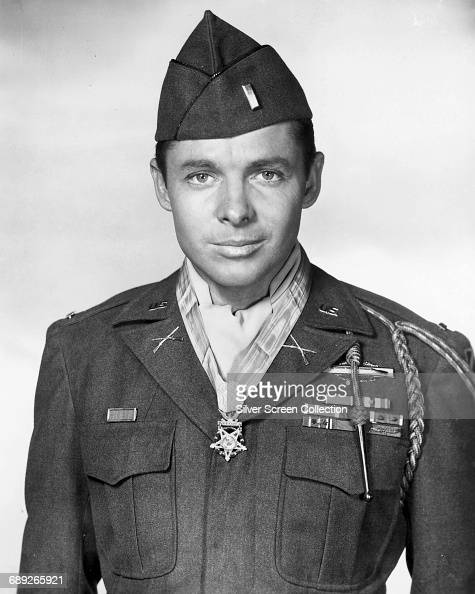 American soldier and actor Audie Murphy plays himself in the autobiographical film 'To Hell and Back' 1955 He is wearing the US Army Medal of Honor...