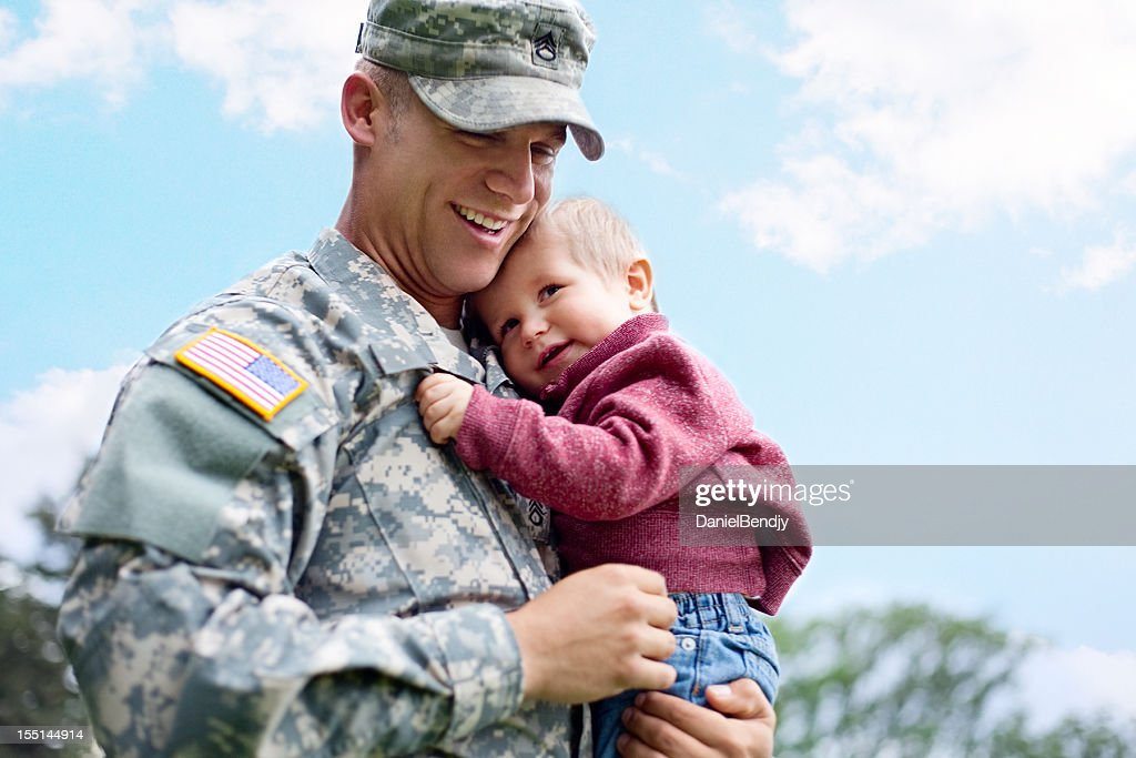 American soldier and son in a park : Stock Photo