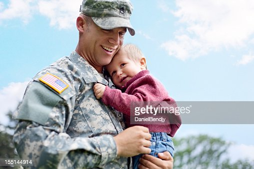 American soldier and son in a park