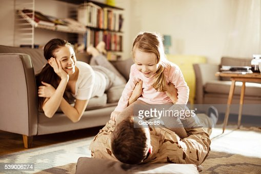 american soldier finally at home with his family stock photo getty images. Black Bedroom Furniture Sets. Home Design Ideas