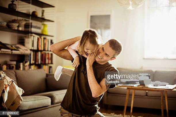 American soldier playing with his daughter