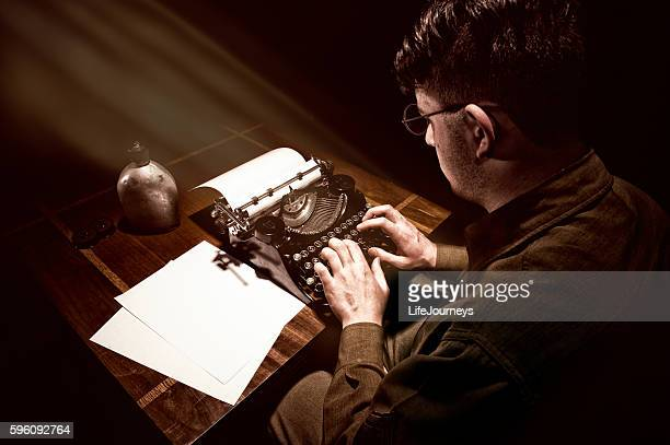 WWII American Soldier Sitting At His Typewriter Typing