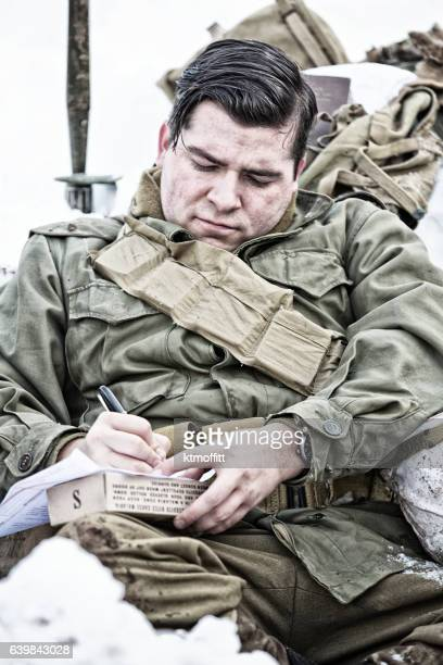 WWII American Soldier Sitting In Foxhole Writing Letter Home