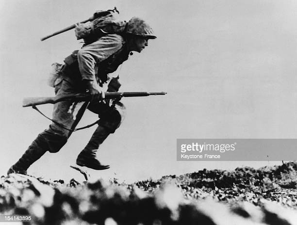 American soldier under fire of Japanese machine guns in the Death Valley where 125 US soldiers were killed in May 1945 in Okinawa Japan