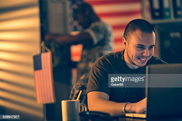 American soldier using laptop