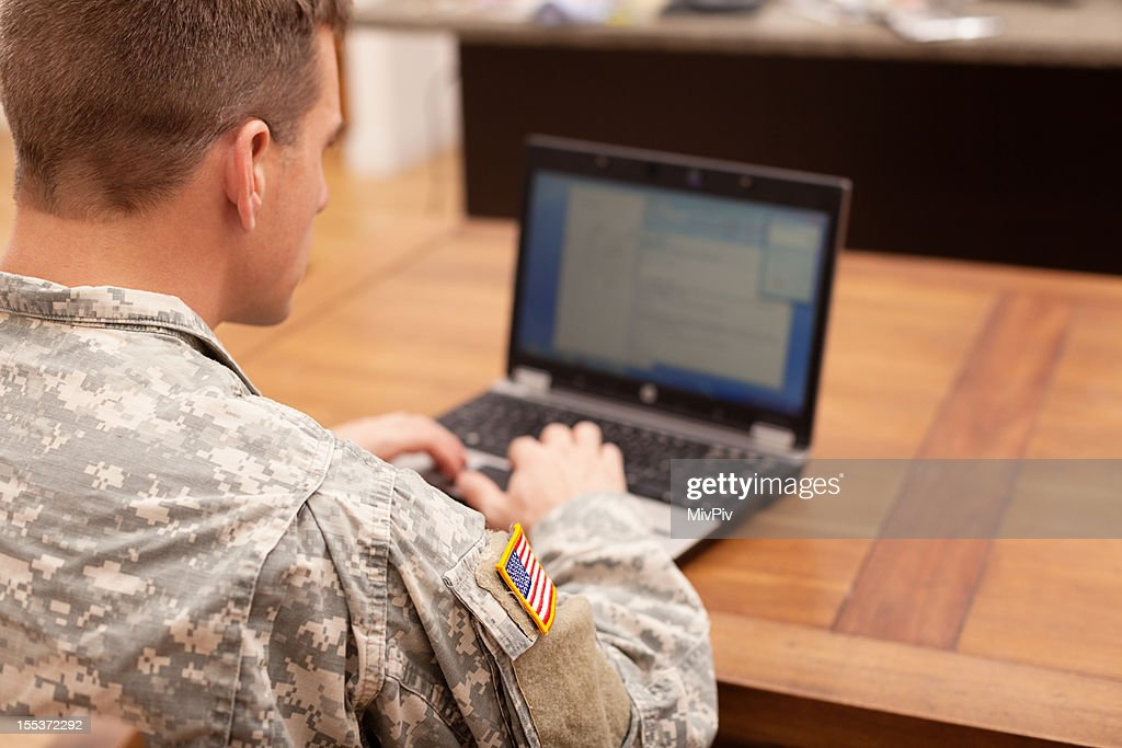 American soldier working on laptop
