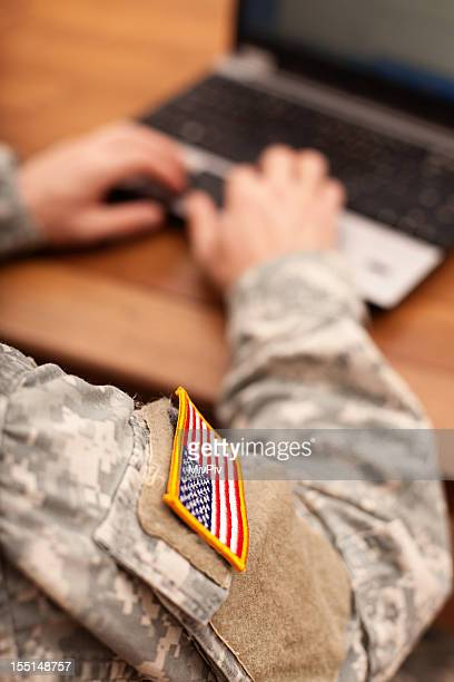 American soldier writing on a laptop