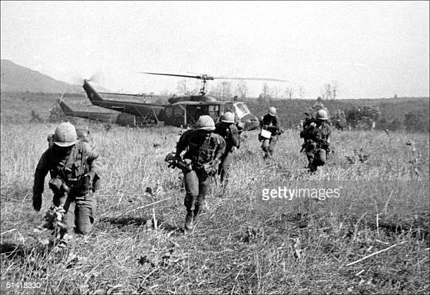 American soldiers get off helicopters during the operation 'Double eagle' against a Vietcong position at Bon Son south Vietnam 07 March 1966