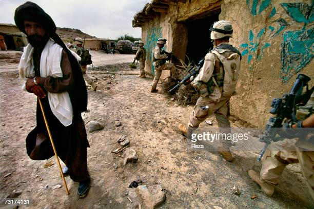 American soldiers go on patrol in the bazaar of the village of Rabat and around in the Pashtun tribal zone of Waziristan on July 2004 in Afghanistan