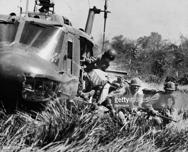 American soldiers jump out of a helicopter during a combat assault near M Tho in the Mekong Delta South Vietnam 1971