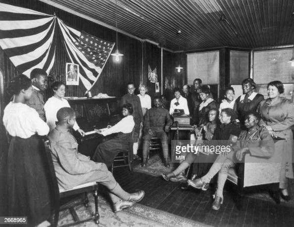 American soldiers listen to a pianist in a Newark New Jersey club opened by coloured women to care for men in the service The US Army at this time...