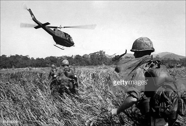 American soldiers of the 173th airborne are evacuated by helicopter from a Vietcong position 11 December 1965
