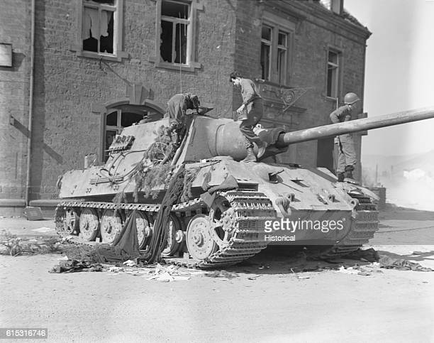 American soldiers of the Tenth Armored Division inspect a captured German Tiger tank